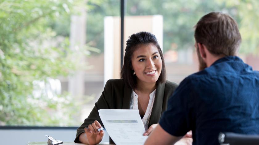 Businesswoman interviews candidate