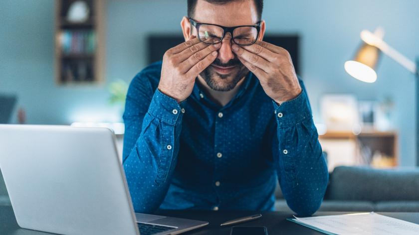 man looking stressed in home office