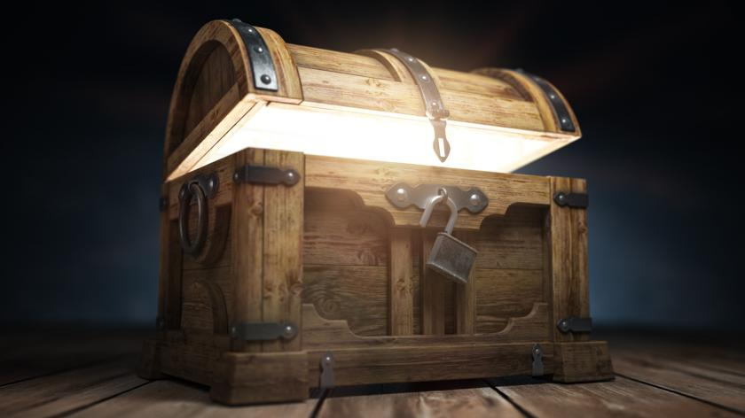 Old wooden treasure chest box with glow from inside. 3d illustration