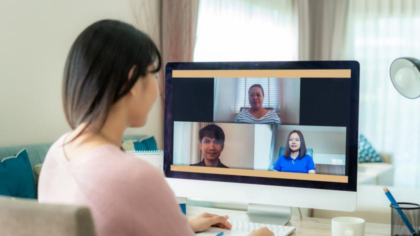 business woman working from home talking to colleagues on video conference