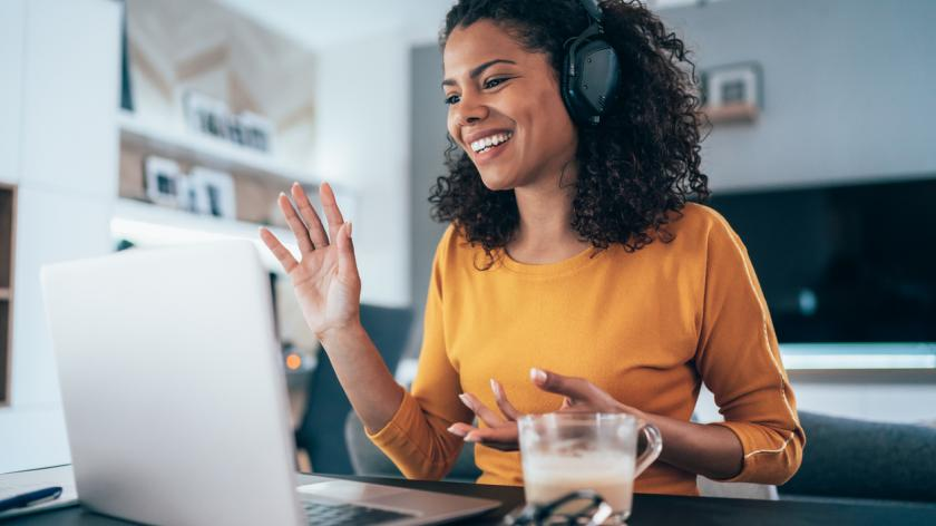 Woman working from home on video conferencing call