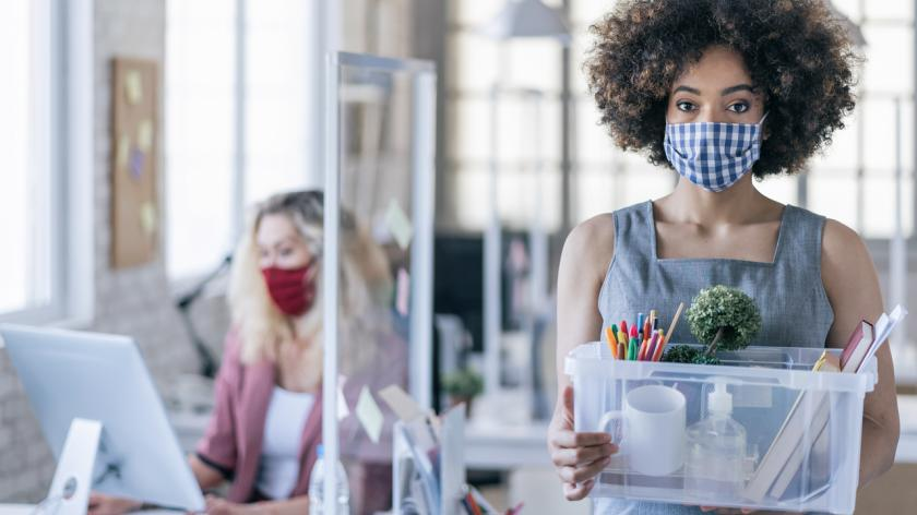 Woman resigning with facemask on during pandemic