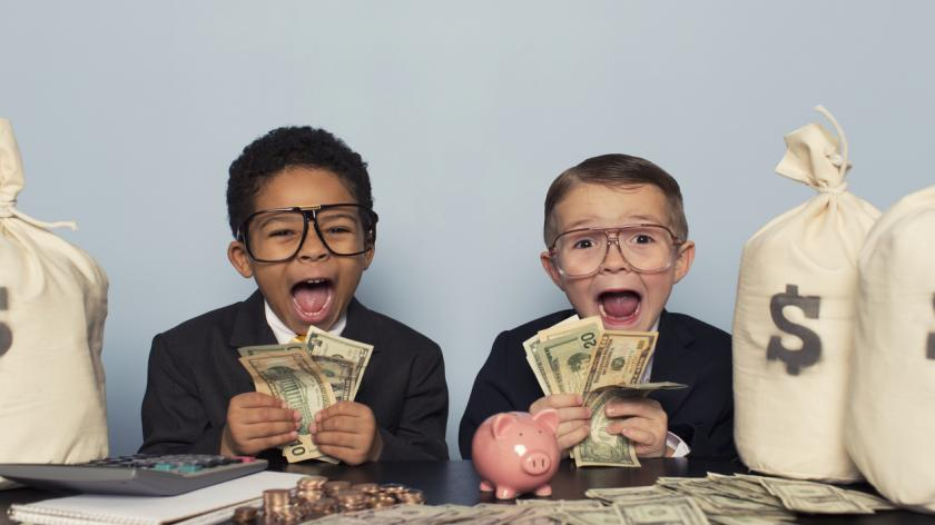 Young Business Children Make Faces Holding Lots of Money