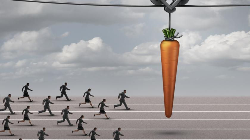 illustration of employees chasing a carrot