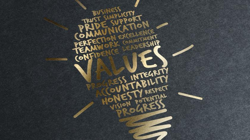 Bulb logo printed in gold leaf with the word 'values' in the centre