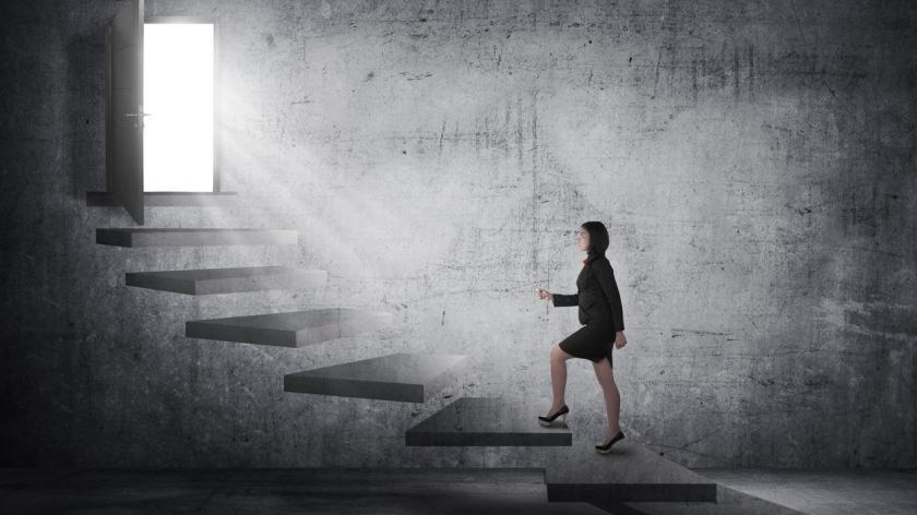 woman climbing stairs career ladder