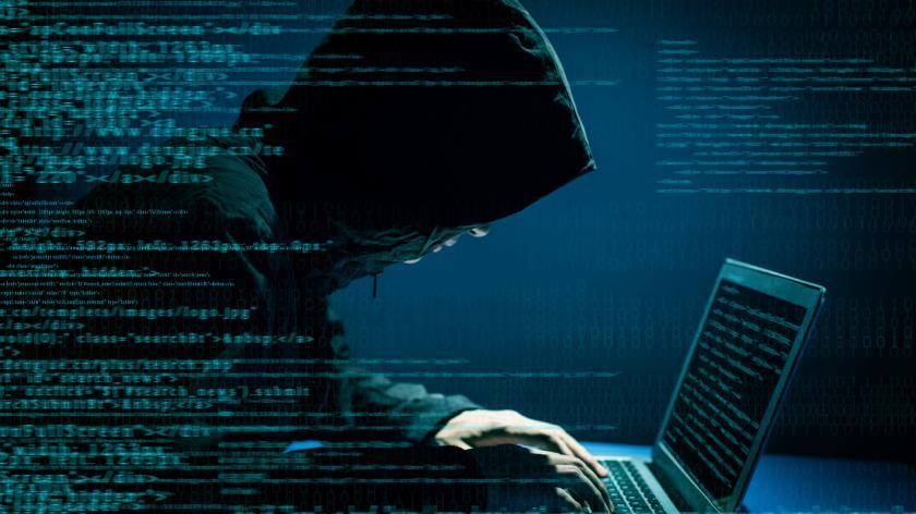 Hacker cybercriminal on laptop