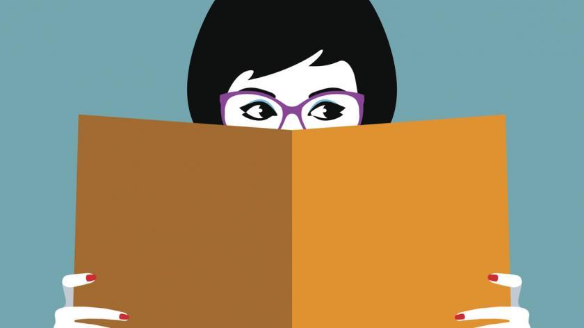 Women's face behind book