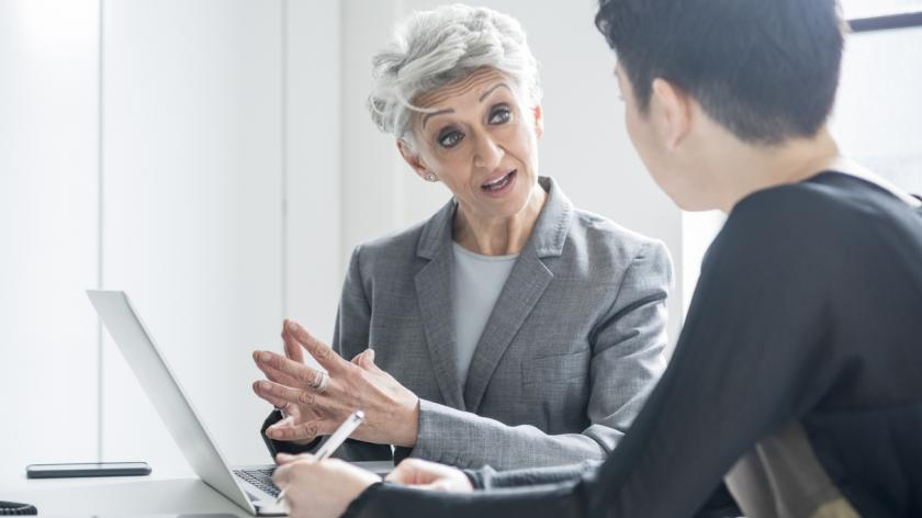Senior businesswoman discussing with young female colleague