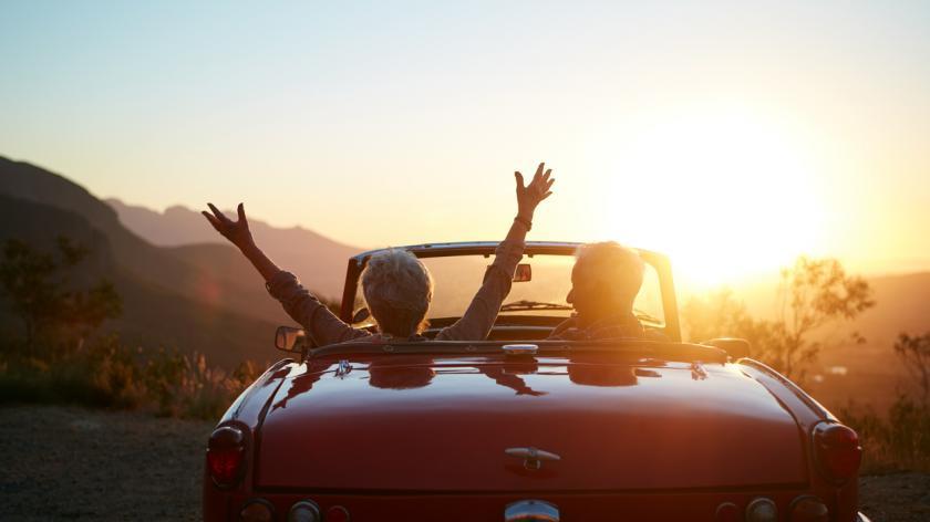 Shot of a joyful senior couple enjoying the sunset during a roadtrip