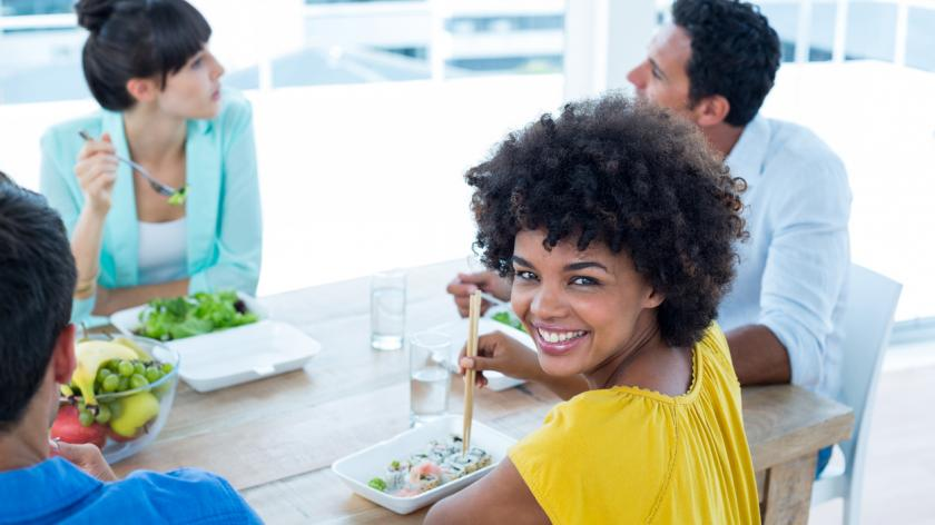 Smiling businesswoman having lunch