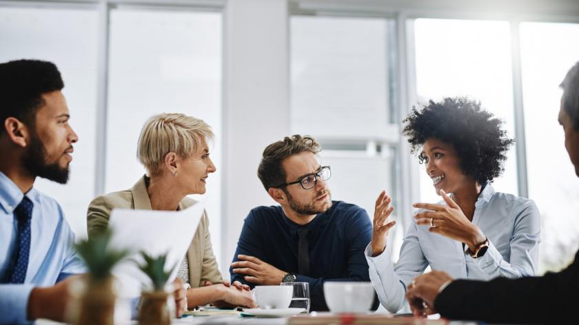 employees communicating in a meeting
