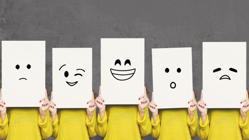 Girl covering face with white boards. Set of painted emotions stock photo