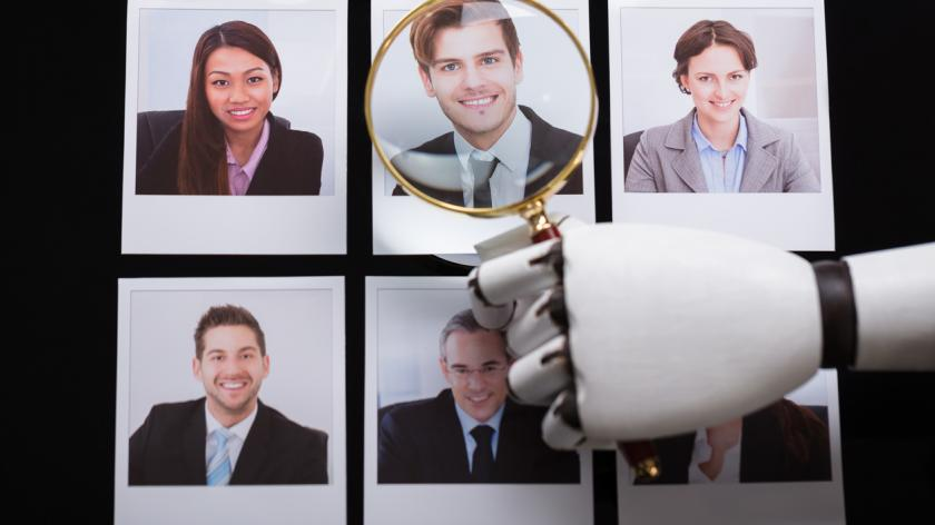 robot arm sorting candidate photos