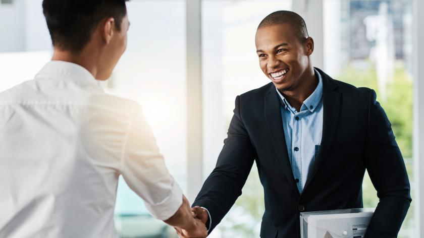 man being welcomed to a new job handshake