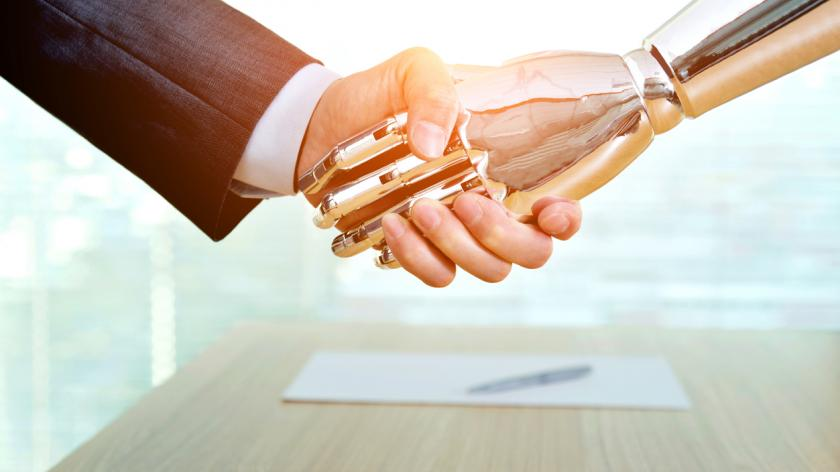 Businessman and robot shaking hands