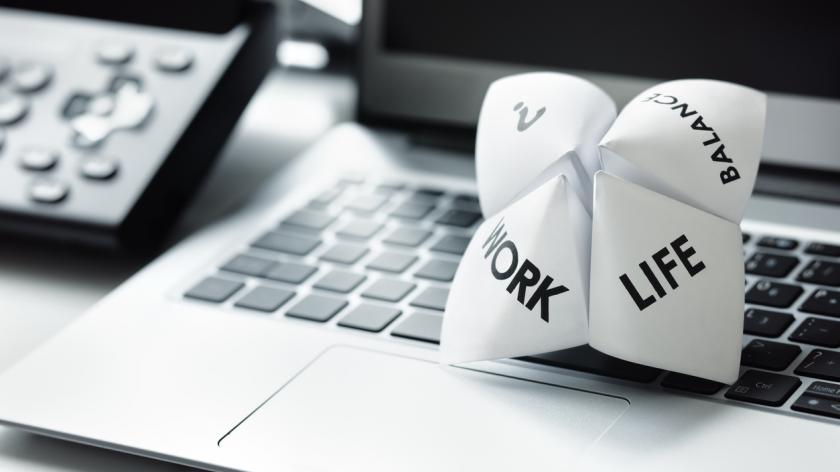 work/life balance paper on a desktop