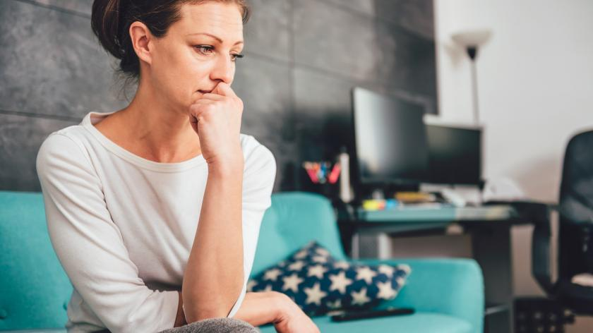 Woman having anxious thoughts at work