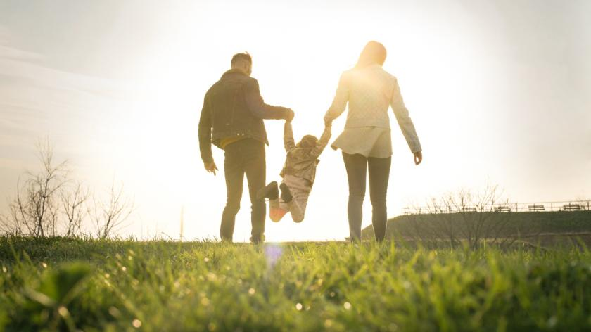Parents and child in a park