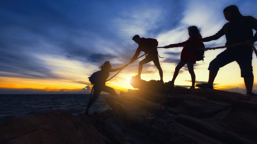 Team climbing mountain