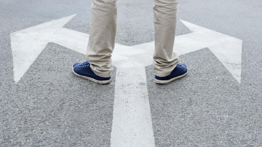 Man facing uncertain directions