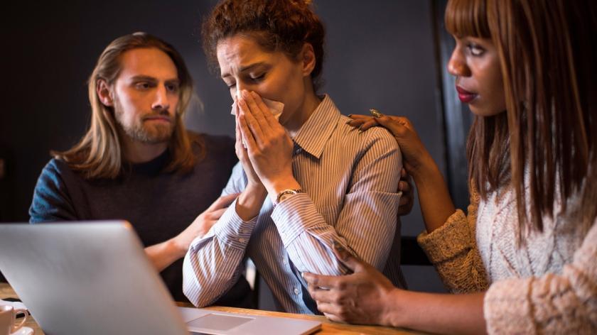 Crying woman at work