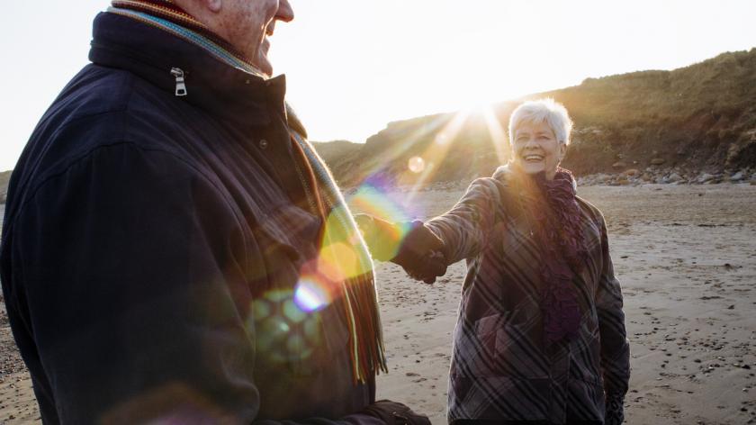 Senior Couple on the Beach Holding Hands
