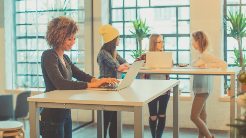 Employers at standing desk