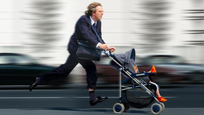 working dad pushing pram in a hurry