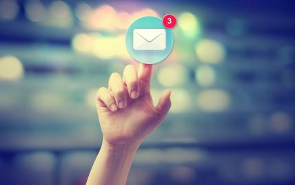 Hand pressing an email icon