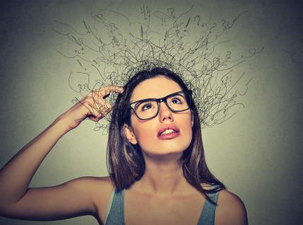 Woman scratching head, thinking brain melting into lines