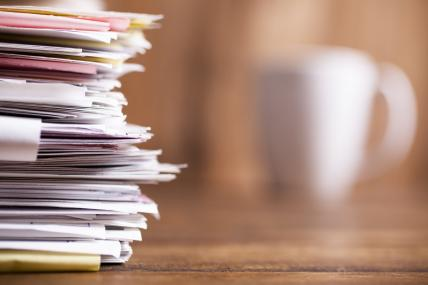 Large stack of files, paperwork. Close-up. Desk, office. Nobody